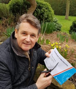 Jonathan Wood cutting up his Conservative Party membership card